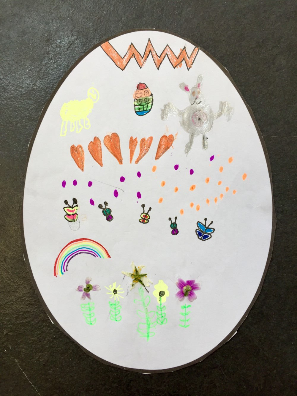 Egg telling the story of Easter and Spring - real flowers at bottom - Clara Smith (age 6)